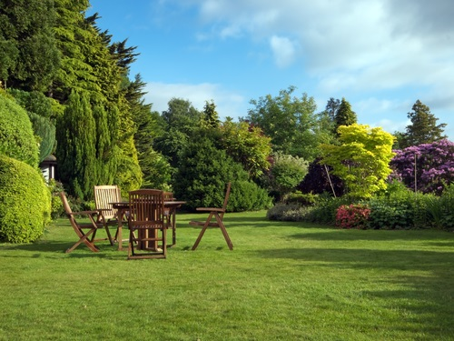 English garden in summer with furniture